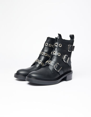 Black studded buckle boots - View all > - Nícoli