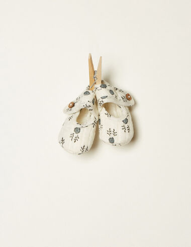 White buttoned shoes with blue twigs details - View all > - Nícoli