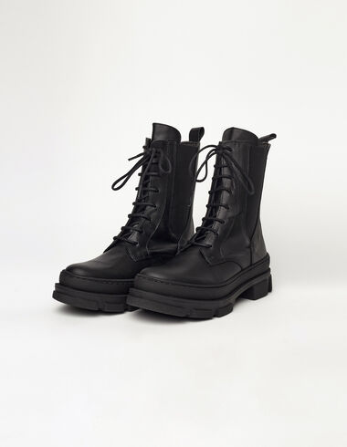 Black military boots with elastic side gussets - View all > - Nícoli