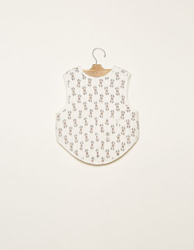 White crossbody bib with pink twig details - View all > - Nícoli